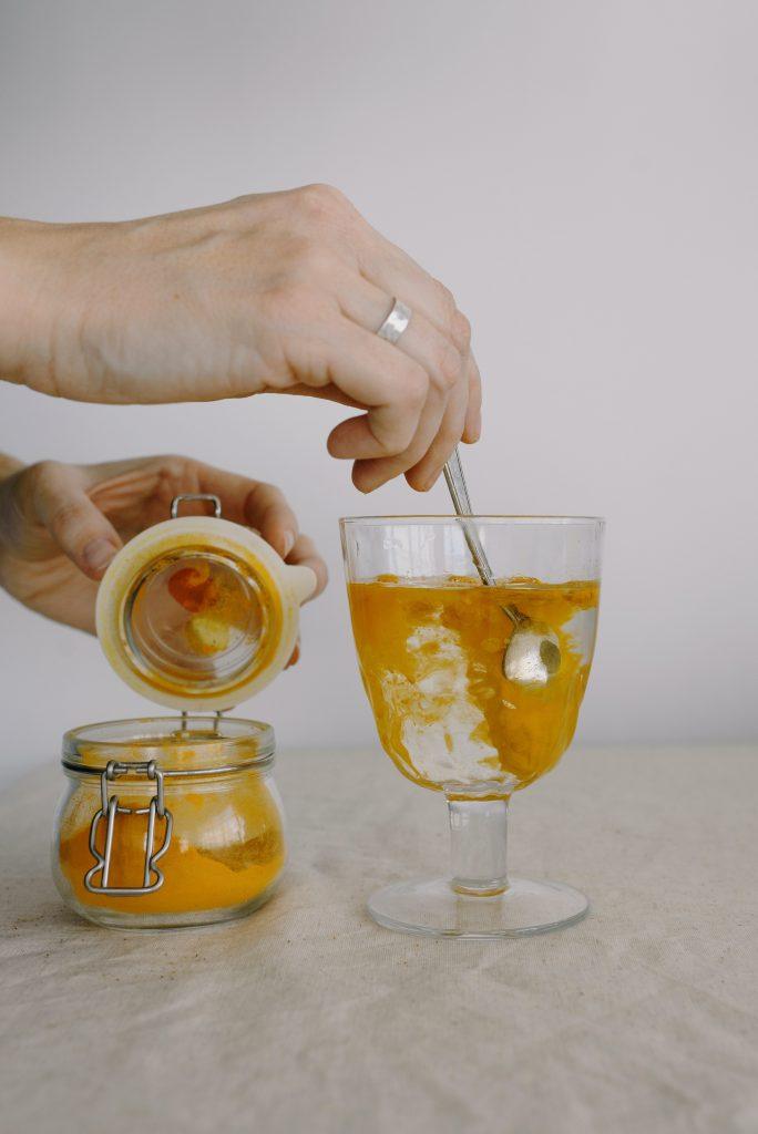 mixing turmeric spice in water
